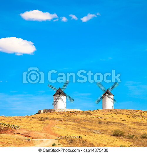 Windmills, rural green fields and blue sky. Consuegra, Spain - csp14375430