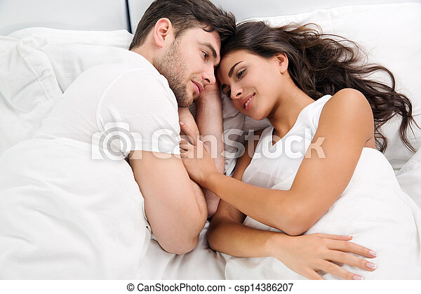 Young adult couple in bedroom - csp14386207