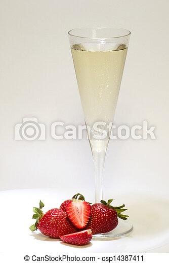 Champagne glass and strawberries