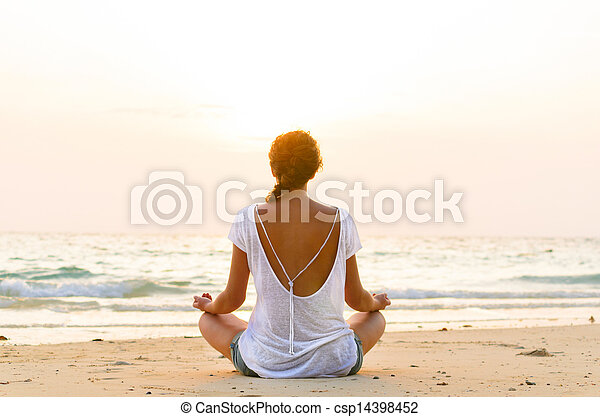 sitting on beach at sunrise - csp14398452