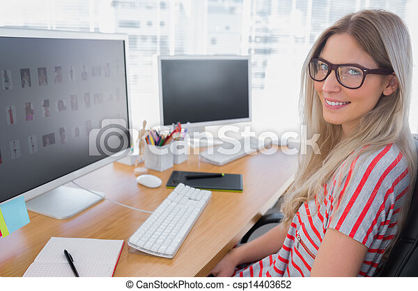 Attractive photo editor working on computer - csp14403652