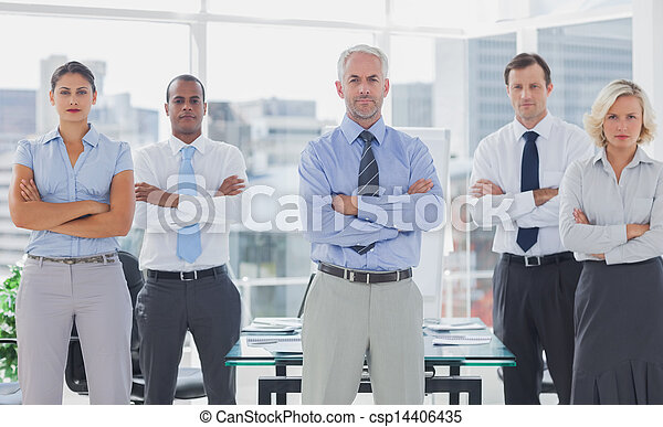 Team of business people standing with arms folded - csp14406435