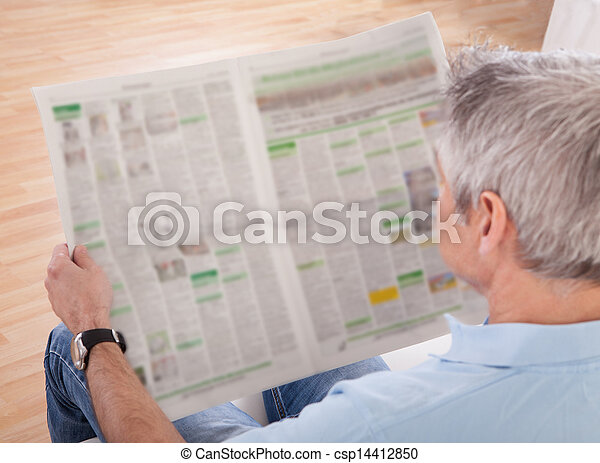 Mature Man Reading Newspaper - csp14412850