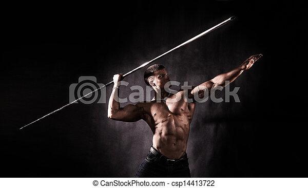 Bodybuilder throwing javelin - csp14413722