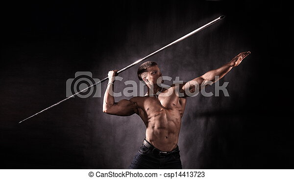 Bodybuilder throwing javelin - csp14413723