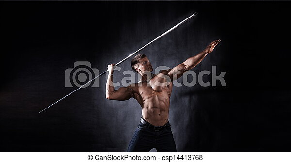 Bodybuilder throwing javelin - csp14413768