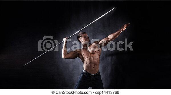 Bodybuilder throwing javelin - csp14413768