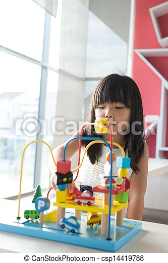 Child playing toy - csp14419788