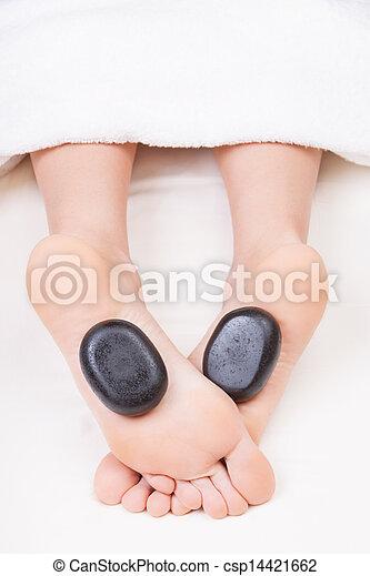 Hot stone reflexology feet massage - csp14421662
