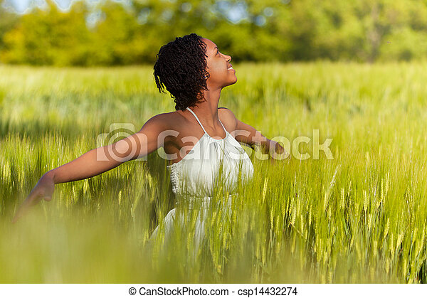 African American woman in a wheat field - African people - csp14432274