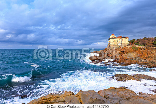 Ocean wave and rocks. Boccale castle landmark. Tuscany, Italy. - csp14432790