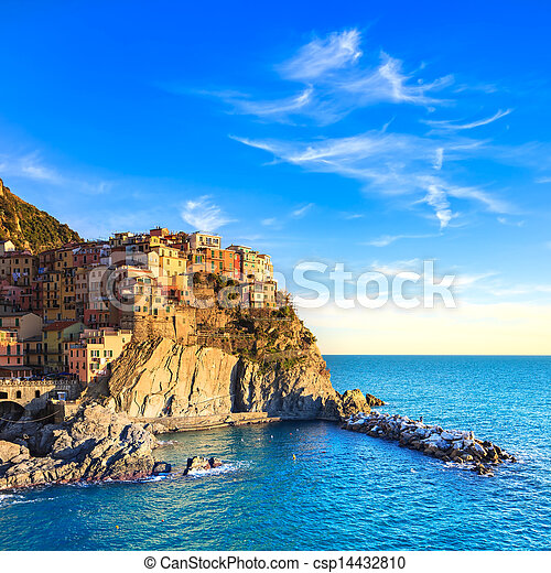 Manarola village, rocks and sea at sunset. Cinque Terre, Italy - csp14432810