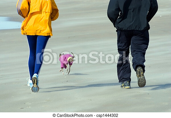 domestic pair with dog on the beach of ocean
