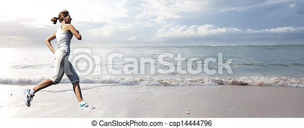 Woman running on the beach. - csp14444796