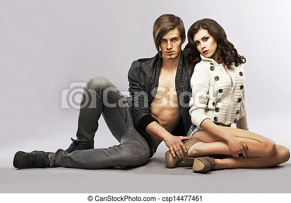 Sentimentality. Fashion Couple - Handsome Man and Classy Woman sitting. Togetherness - csp14477461