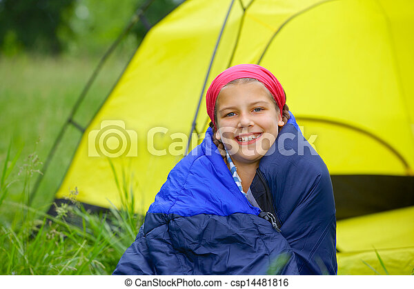 Young girl camping