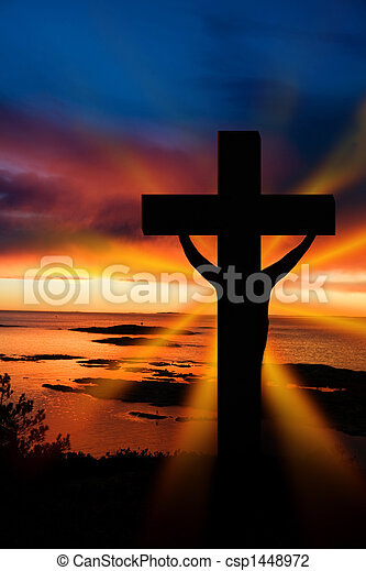 A cross at sundown on the ocean
