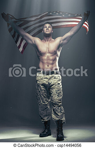 Good looking men with flag in smoke - csp14494056