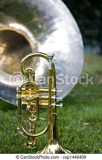 Trumpet with Band Instruments in Background - csp1449409