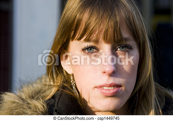 Young Adult Woman with Serious Expression - csp1449745