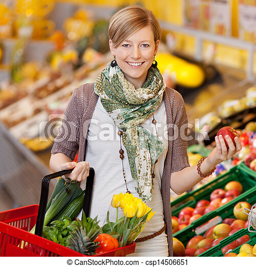 Smiling woman shopping for fresh produce