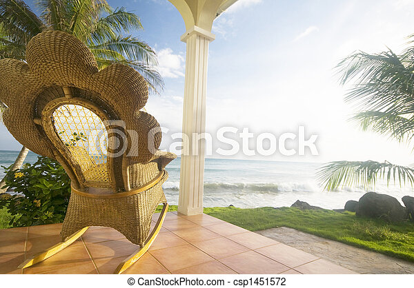 handmade wicker rocking chair on patio luxury resort hotel caribbean sea rural big corn island nicaragua central america - csp1451572