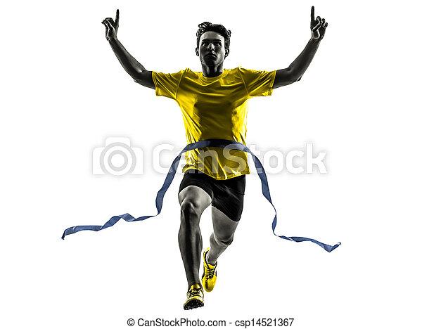 young man sprinter runner running winner finish line silhouette - csp14521367