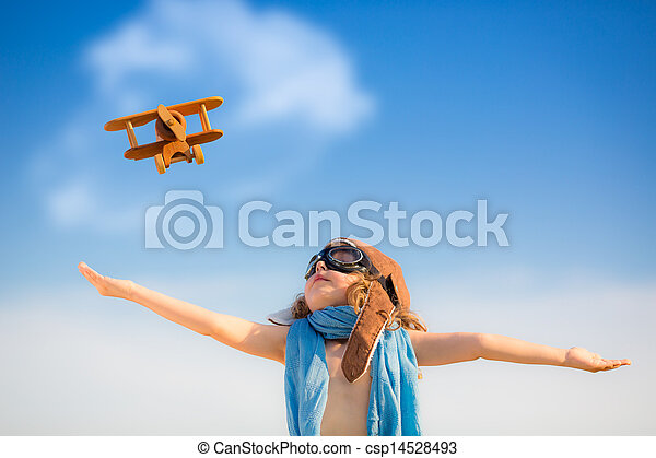 Happy kid playing with toy airplane - csp14528493