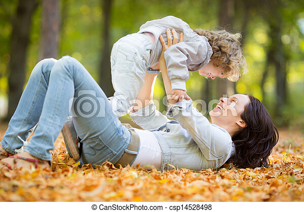 Happy family in autumn park - csp14528498