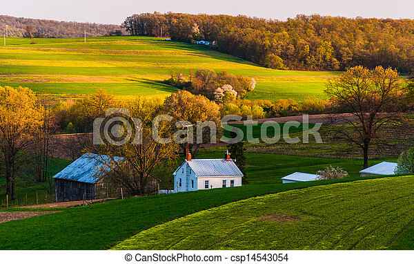 Home and barn on the farm fields and rolling hills - csp14543054