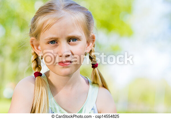 portrait of a smiling girl in a park - csp14554825