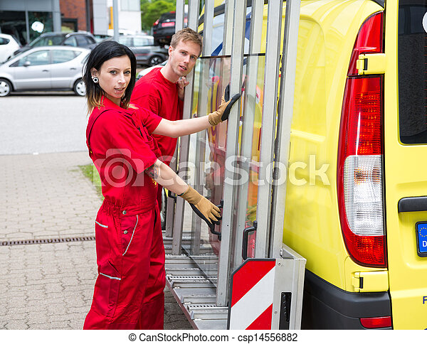 Glaziers with glass transportation truck - csp14556882