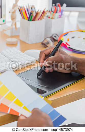 Interior designer with graphics tablet and colour chart - csp14573974