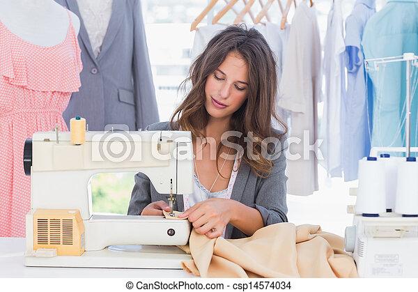 Fashion designer sewing - csp14574034