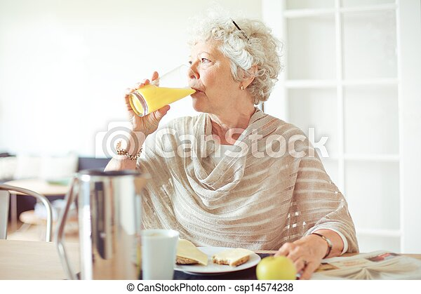 Elderly Woman Drinking Juice - csp14574238