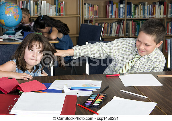 Elementary school students studying - csp1458231