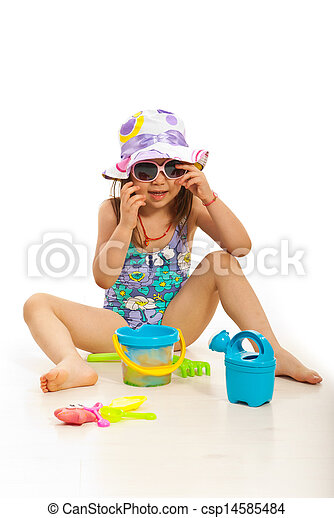 Funny girl with beach toys - csp14585484