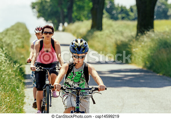 Mother with two sons on bicycle trip - csp14599219