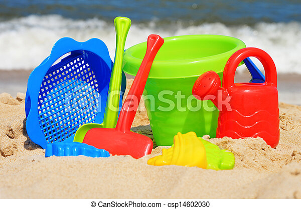 Plastic children toys on the sand beach - csp14602030
