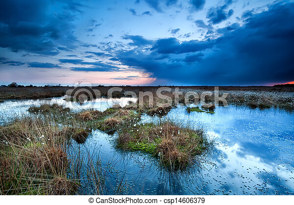 storm clouds over lake at sunset - csp14606379