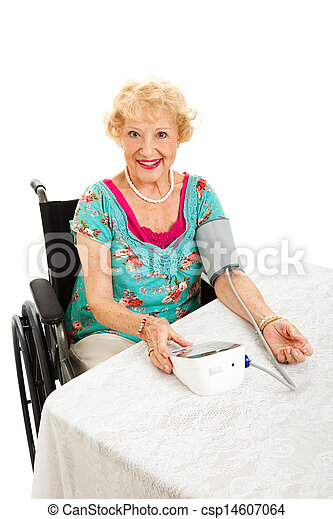 Beautiful Senior Takes Own Blood Pressure - csp14607064
