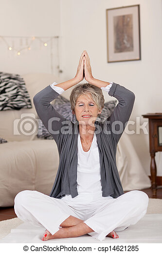 Relaxed Senior Woman During Yoga - csp14621285