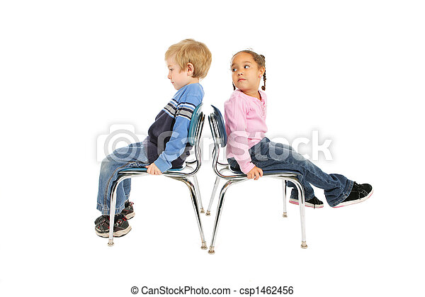 Two children sitting back to back - csp1462456
