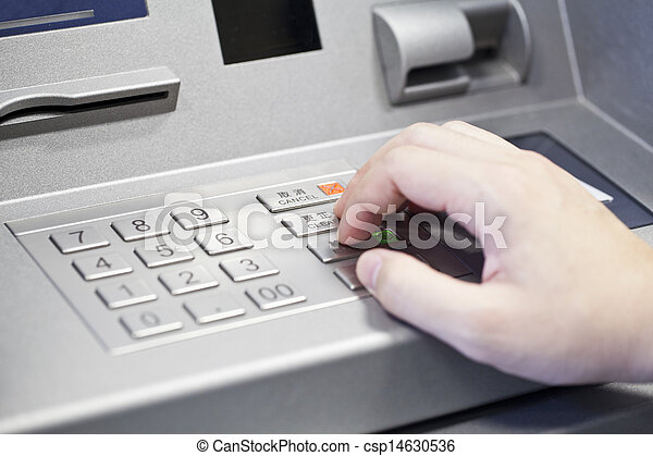 Human hand enter atm banking cash machine pin code  - csp14630536