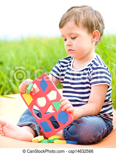Little boy is playing with toys - csp14632566