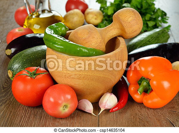 Wooden mortar and fresh vegetables - csp14635104