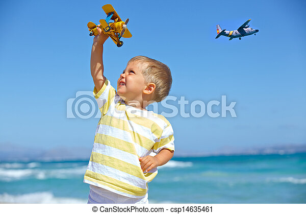 Boy playing with a toy airplane - csp14635461