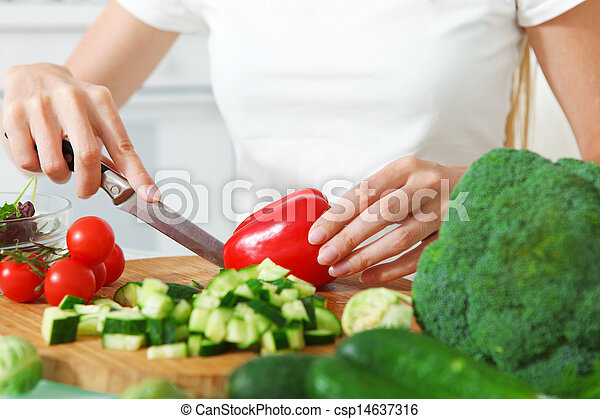 Woman's hands cutting vegetables - csp14637316