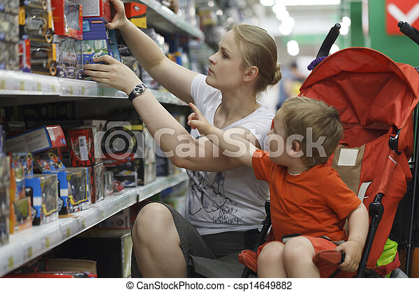 Mother and son shopping for toys - csp14649882