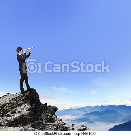 business man looks through telescope on mountain - csp14651028
